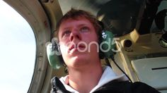 Man sitting in a helicopter with headphones - Stock Footage | by JahnProductions