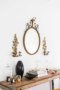 Eclectic console table and vintage mirror