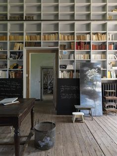 Library and studio of Claire Basler, located in a former schoolhouse on the outskirts of Paris. | Remodelista