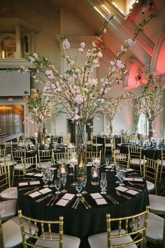Tall, pink wedding centerpiece idea - tall glass vases with cherry blossom branches {OLLI STUDIO}
