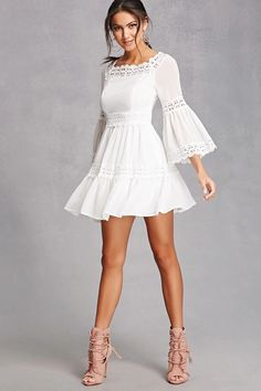 A woven swing dress featuring a floral scalloped crochet trim, a boat neckline, 3/4 length bell sleeves, and a concealed side zipper.<p>- This is an independent brand and not a Forever 21 branded item.</p>