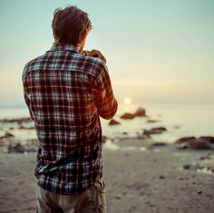 Plaid, and the sunrise, and the sand, and the man. If only I were there too.
