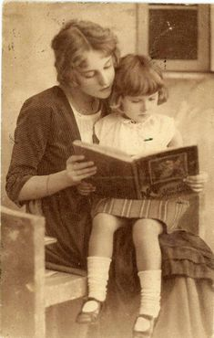 A mother reading with her child.
