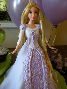 Barbie cake idea. I like this one because the dress flows nicely along the dolls waist. Some just look like a doll stuck in an upsidedown bowl.