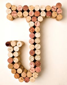 DIY wine cork crafts. We love this wall art for a kids room or kitchen.