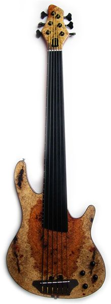 "SHUKER Artist Bass Guitar. Gorgeous warm wood colors- RESEARCH #DdO:) - BASSes OF LIFE. 4, 5 or 6 string models available with 24 frets= marked only on sides to give fretless sound. 33"", 34"" or 35"" scale. 5 or 7 piece laminate, mahogany/  chambered body. All instruments by this UK company re  made to order & customers individual specifications. They do have a stock that I presume they build as they have time; a fun site to check out with some unique #instruments. Photo pinned via wernermeth."