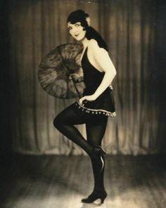 Silent star Carmelita Geraghty poses in a black slip