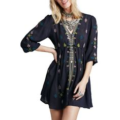 """A drawstring Empire waist cinches the silhouette of a gauzy tunic dress styled with a plunging neckline and gathered three-quarter-length sleeves. - 33 1/2"""" length (size Medium). - Slips on over head."""