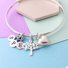 Sophie Jones Jewellery Family Tree Bangle (75 CAD) ❤ liked on Polyvore featuring jewelry, bracelets, sterling silver letter charms, initial charms, bangle bracelet, sterling silver bangles and letter charms