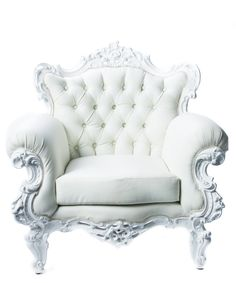 BAROQUE CHAIR ROLL ARM - This divine rolled arm chair is lavishly carved with intricate three-dimensional carvings on both the front and back so that the chair looks fantastic no matter where you place it. It is then finished in a lustrous gloss white and upholstered in coordinating eco-leather that gives it classically divine appeal. 39 X 33 X 39 IN 121#