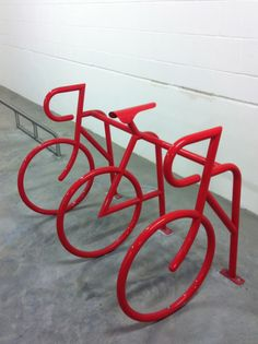 Would love to have a cute bike rack like this at our house!