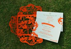 red laser cut invites, red and white , summer wedding, bright , open envelope