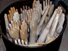 Vintage glove molds, kinda creepy but makes an interesting statement.