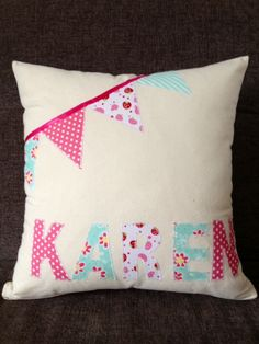A lovely personalised name cushion with bunting detailing A lovely cushion featuring any name you like Each letter is cut from carefully chosen Sewing Tutorials, Sewing Crafts, Sewing Projects, Sewing Patterns, Diy Cushion, Cushion Ideas, Cushion Covers, Cushion Embroidery, Letter Cushion