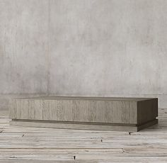 RH's Geometric Panel Rectangular Coffee Table:Simple shapes and crisp lines showcase the rich texture of American oak in our boldly proportioned Geometric Panel collection, designed by Richard Forwood. Inspired by 1970s postmodern design, each table is set on a grooved, plinth base that lightens the silhouette and adds a subtle yet signature detail.