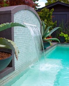 Swimming Pool Fountain Ideas fountains into pool stone wall evergreens Find This Pin And More On Pool