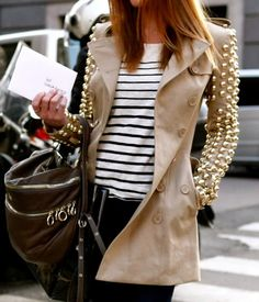 Studded trench coat, paired with striped sweater -- super cool chick...