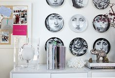 Dishes are not only reserved for dining areas, these Fornasetti plates are on display in our co-founder's office!