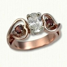 14kt Rose Gold Celtic Twin Hearts Engagement Ring  set with an oval diamond and side garnets. All stones available in any metal