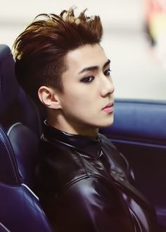 sehun and that infamous leather shirt that every member feels the need to sport-.-