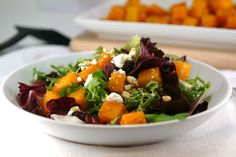 Roaster butternut squash salad with maple balsamic vinaigrette. Cold-weather food doesn't have to be heavy!