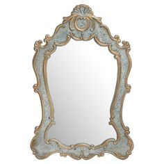 Add artful appeal to your entryway or master suite with this eye-catching wall mirror, featuring a scrolling frame and gold and silver finish.