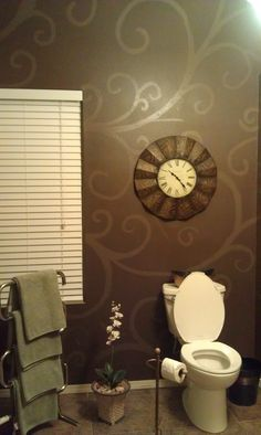 I want to do this in my bathroom, pinner said she used a matte or flat paint and then same color in a high gloss for the design and used a stencil or if your artistic you can free hand it. Love it! Color is Coffe Bean by Ralph Loren. Click on the link to the upper right.