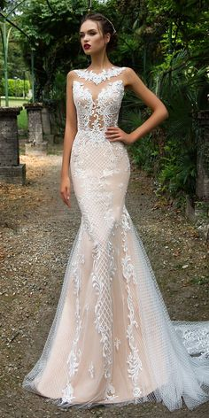 Admirable mermaid silhouette wedding gown Salma is made of classy gauze covering a nude base. The mirror pattern lace is manually beaded and embellished with Swarovski crystals. The back is decorated with fishnet trail and delicately buttoned up.