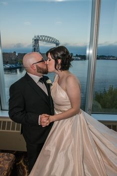 A kiss with a view!  Aerial Lift Bridge, Harbor Side Ballroom, DECC, Duluth, MN Weddings @missy