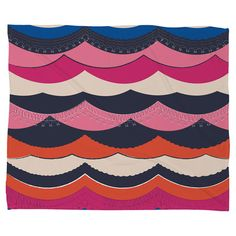 Fleece blanket with a multicolor scalloped motif.