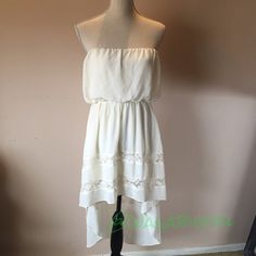 Whimsical Boho White Summer Hi Low Dress New without tags, never worn. Beautiful off white chiffon dress is perfect for summer. Wear with sandals or heels. Dress is Lined. Flowy when you walk. Tag is Small. Strapless top can fit up to a Medium. 100% Polyester, lining 50% cotton/ 50% nylon. No Trades Dresses Strapless