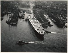 Photograph from between 1952-1953 of the S.S. New Amsterdam departing Holland America Lines 5th St. Pier, Hoboken NJ.  (Hoboken Historical Museum)