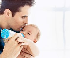 12 Ways for Dad to Bond with Baby:  Bonding with a newborn can be overwhelming, especially for dad. We've gathered a few fun ways for him to spend a little extra time with his little one.