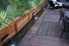Asian Patio with Wood Landscape Retaining Wall, Raised beds, Fountain, Ipe Deck Tiles (12 x 12)