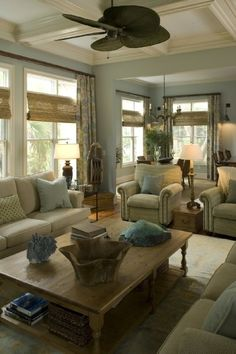Living Room with lots of seating and natural light.  Love the ceiling too!  Other lovely decorating ideas on this sight