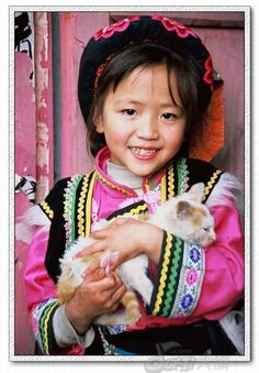 Cute little Qiang girl  with her cat