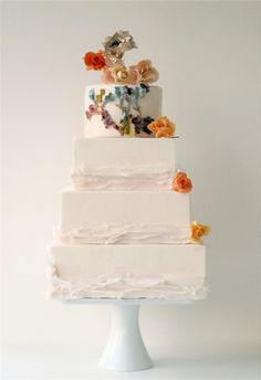 wedding cake with floral ruffle, a modern and elegant look; love how the ruffle is incorporated by doesn't overtake the cake:)