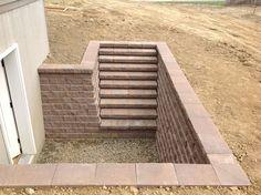 Basement steps using segmental retaining wall blocks.