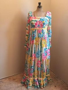 Vibrant vintage Lilly Pulitzer maxi dress. Sheer top lay with sold under layer. Sleeves are sheer. Zipper and tie back. There are some small holes from age, please refer to photos. Rare Iconic Lilly Pulitzer dress, flattering and comfortable. Great addition to any wardrobe. The item was