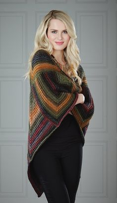 Mitered blocks of garter stitch are joined as you work, no sewing required. Shown in (557) Umbria or choose any color.