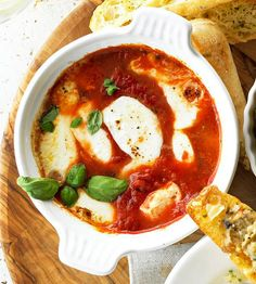 "Baked Mozzarella and Tomato-Basil Antipasti. ""With only 15 minutes of prep time, this rich spread for toasted baguette slices is easy to make and hard to resist."" Oh, yum. Sauce Spaghetti, Gula, Appetizer Recipes, Holiday Appetizers, Cheese Appetizers, Holiday Treats, Snack Recipes, Soup And Salad, The Fresh"