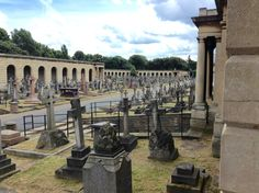 View of the numerous tombs along Center Avenue leading to the central roundrel of Brompton Cemetery, London, England, near the Chapel close to the south end.  Below the colonnades are catacombs which were originally conceived as a cheaper alternative burial to having a plot in the grounds of the cemetery. Unfortunately, the catacombs were not a success and only about 500 of the many thousands of places in them were sold.