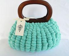 Aqua blue pom pom purse