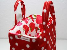 Cover a basket tote with fabric -- include pockets on the lining!