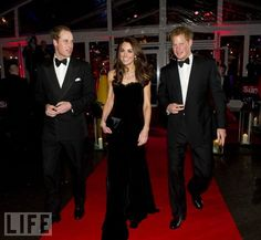 Royal Entrance at the Sun Military Awards (December 19)  Wearing Alexander McQueen and flanked by her husband Prince William and her brother-in-law Prince Harry, Catherine arrives to honor members of the armed forces at London's Imperial War Museum. #katemiddleton #princewilliam #princeharry #duchessofcambridge
