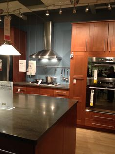 I found this display at Ikea. I love the paint color with the Cherry cabinets and dark countertops. This means it can work with our kitchen.