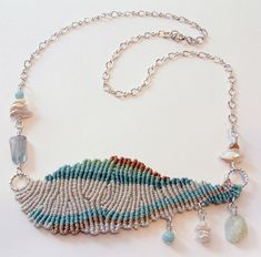 inspiration for (long) pendant (with long dangles?)-- by smitten by a knot