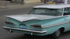 1959 Impala is, to me, the ultimate Impala. The deep horizontal fins really do it for me. And check it out - apparently it's just a taxi in Cuba.