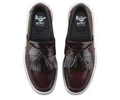 f0b0db669b1 The Edison tassel loafer features a traditional loafer design with kiltie  fringe and double tassel.