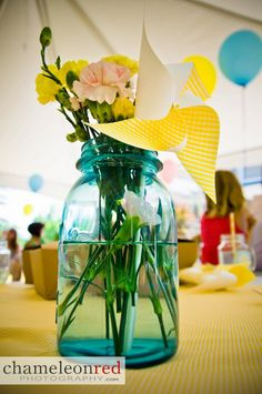 Love this idea with the simple flowers and add a pinwheel for the centerpieces!
